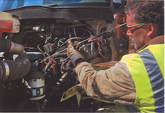 Checking the oil on the Nordic Waste 2006 International 7400 rear loading refuse hauler with a Navistar DT466 7.6L inline six cylinder diesel engine